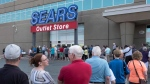 Shoppers stand in line waiting for a Sears outlet store to open in Halifax on Friday, July 21, 2017. Dozens of Sears stores destined for closure will begin liquidation sales today, but experts warn bargain hunters to temper their expectations. The ailing retail giant is counting on shoppers to scoop up discounted merchandise as soon as possible so it can avoid bankruptcy. THE CANADIAN PRESS/Darren Calabrese