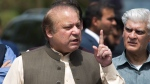 In this Thursday, June 15, 2017, photo, Pakistani Prime Minister Nawaz Sharif speaks to reporters outside the premises of the Joint Investigation Team, in Islamabad, Pakistan. P(AP Photo/B.K. Bangash)