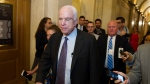 Sen. John McCain, R-Az., is pursued by reporters after casting a 'no' vote on a a measure to repeal parts of former President Barack Obama's health care law, on Capitol Hill in Washington, Friday, July 28, 2017. (AP Photo/Cliff Owen)