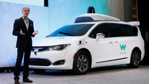 John Krafcik, CEO of Waymo, the autonomous vehicle company created by Google's parent company, Alphabet, introduces a Chrysler Pacifica hybrid outfitted with Waymo's own suite of sensors and radar. (AP Photo/Paul Sancya, File)