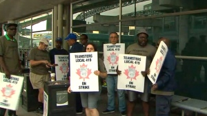 Unionized ground crew workers are on strike at Pearson airport in Toronto, Friday, July 28, 2017.