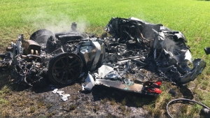 The Ferrari 430 Scuderia, worth about 200,000 pounds (US$260,000) new, ended up a burning heap in a field. (SYP Ops Support/Twitter)