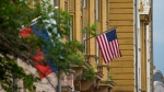 U.S. and Russian flags hung at the U.S. Embassy in Moscow, Russia, Friday, July 28, 2017. (AP Photo/Alexander Zemlianichenko)