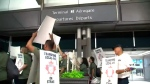 Hundreds of baggage handlers at Pearson Airport strike at Terminal 3 on July 27, 2017.