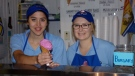 Camryn Seymour (left) and Lanie Pearson (right) serve an ice cream cone at Sully's Ice Cream Parlour in Sussex, N.B.
