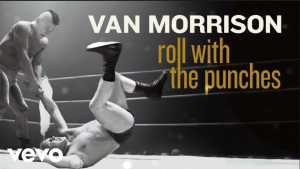 "Billy Two Rivers, LEFT, is featured on the cover of Van Morrison's 37th studio album ""Roll with the Punches,"" but is suing for unlawful use of his image. (Screengrab from VEVO)"