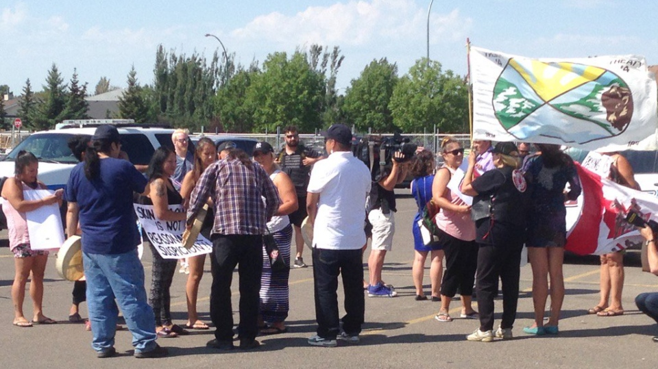 Protesters demonstrate in the parking lot of a Canadian Tire store in east Regina on Friday, July 28, 2017. (DALE HUNTER / CTV REGINA)