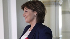 B.C. Premier Christy Clark arrives to speak to the amendment of the throne speech in the legislative assembly before the confidence vote at the B.C. Legislature in Victoria, B.C., on Thursday, June 29, 2017. (Chad Hipolito / THE CANADIAN PRESS)