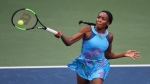 Venus Williams returns to Canada's Genie Bouchard in a special women's exhibition tennis match at the BB&T Atlanta Open Tournament, Sunday, July 23, 2017, in Atlanta. (Curtis Compton/Atlanta Journal-Constitution via AP)
