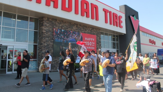Demonstrators gathered at the Canadian Tire in east Regina two days after an alleged assault was captured on camera in the store. (CTV News / Karyn Mulcahy)