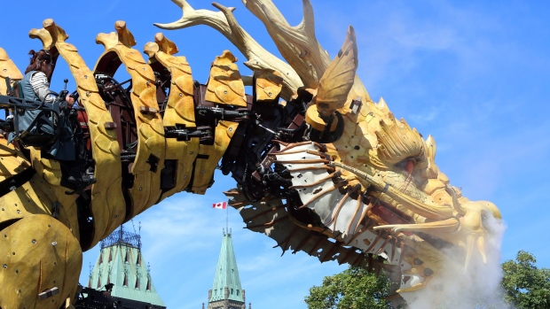 A giant mechanical dragon gets ready to roam the streets of Ottawa in a four-day urban theatre performance involving a 45-ton half-dragon half-horse that towers 12 metres high. Long Ma, named after a Chinese mythological half-dragon half-horse, is shown below Parliament Hill, in Ottawa, Friday, July 28, 2017. THE CANADIAN PRESS/Fred Chartrand