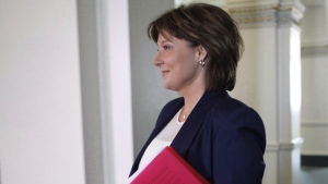 Then-premier Christy Clark arrives to speak to the amendment of the throne speech in the legislative assembly before the confidence vote at the B.C. Legislature in Victoria, B.C., on Thursday, June 29, 2017. THE CANADIAN PRESS/Chad Hipolito