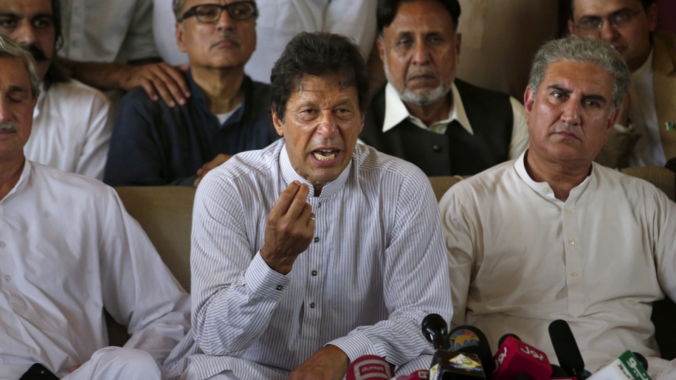 Pakistani opposition leader Imran Khan, centre, addresses a news conference regarding the dismissal of Pakistani Prime Minister Nawaz Sharif, in Islamabad, Pakistan, on July 28, 2017. (Anjum Naveed / AP)