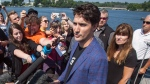 Prime Minister Justin Trudeau speaks with members of the media on the waterfront during a visit to Kenora, Ont., on Friday, July 28, 2017. (THE CANADIAN PRESS/Tom Thomson)
