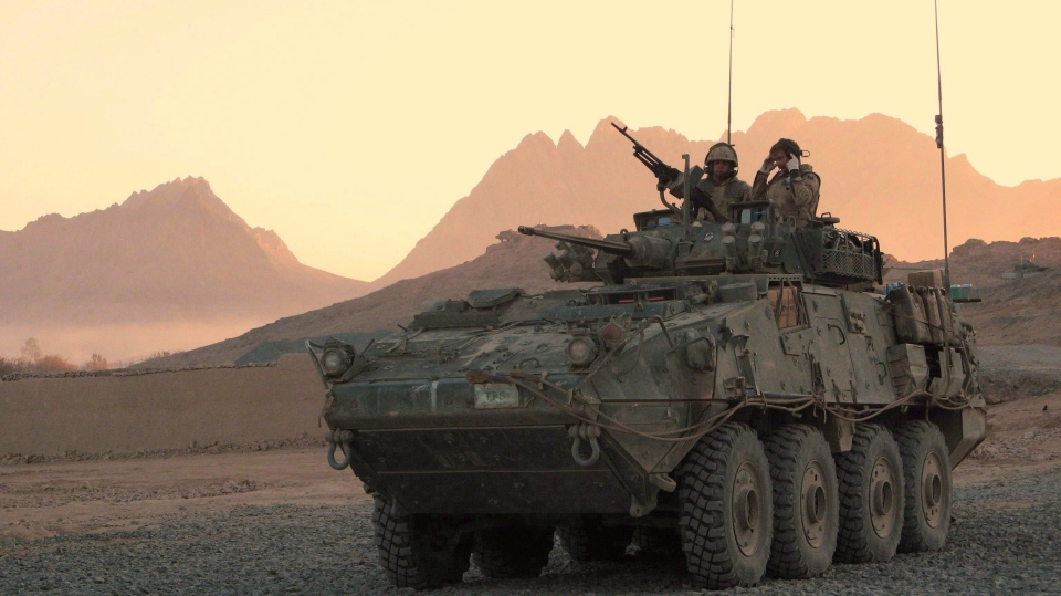 A Canadian LAV (light armoured vehicle) arrives to escort a convoy at a forward operating base near Panjwaii, Afghanistan at sunrise on Nov. 26, 2006. (THE CANADIAN PRESS/Bill Graveland)