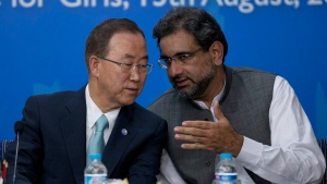 Pakistan's Petroleum and Natural Resources Minister Shahid Khaqan Abbasi, right, talks with visiting UN Secretary-General Ban Ki-moon during his visit to a college to address students in Islamabad, Pakistan, Tuesday, Aug. 13, 2013. (AP Photo/B.K. Bangash)