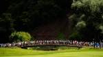 Spectators cross the bridge between the 13th and 14th holes during the Canadian Open golf tournament at Glen Abbey golf club, in Oakville, Ont., on Saturday, July 29, 2017. (Nathan Denette / THE CANADIAN PRESS)