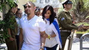 Elor Azaria escorted by his mother arrives to Israeli military court in Tel Aviv, Sunday, July 30, 2017. (AP Photo/Dan Balilty, Pool)