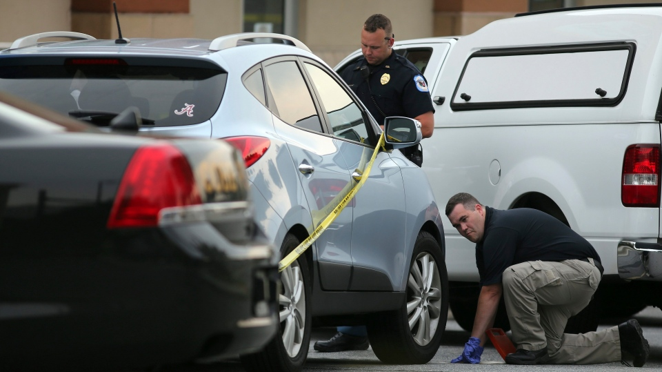 In This June 18 2014 File Photo Cobb County Police Investigate An SUV Where A Toddler Died Near Marietta Ga When The Father Forgot To Drop His Child