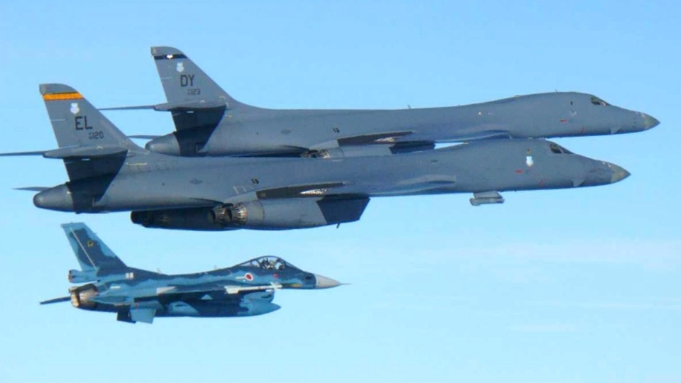 In this photo released by Japan Air Self Defense Force, U.S. Air Force B-1B bombers, top, fly with a Japan Air Self Defense Force F-2 fighter jet over Japan's southern island of Kyushu, just south of the Korean Peninsula, during a Japan-U.S. joint exercise Sunday, July 30, 2017. (Japan Air Self Defense Force via AP)