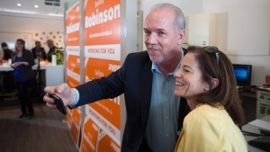FILE -- NDP Leader John Horgan, left, takes a selfie with local candidate Selina Robinson during a campaign stop in Coquitlam, B.C., on Sunday May 7, 2017.(THE CANADIAN PRESS/Darryl Dyck)