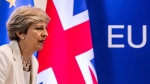 British Prime Minister Theresa May prepares to address a media conference at an EU summit in Brussels on Friday, June 23, 2017. (AP Photo/Geert Vanden Wijngaert)