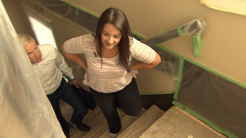 Lydia Cabral shows Ross McLaughlin the repairs being done in her new home. (CTV)