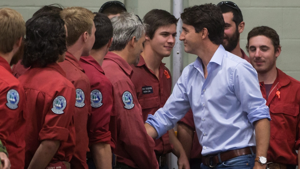 Prime Minister Justin Trudeau meets firefighters, members of the Canadian Forces and RCMP officers in Williams Lake, B.C., on Monday July 31, 2017. (THE CANADIAN PRESS/Darryl Dyck)