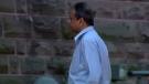 Yogesh Patel walks toward the Woodstock courthouse on Monday, July 31, 2017.