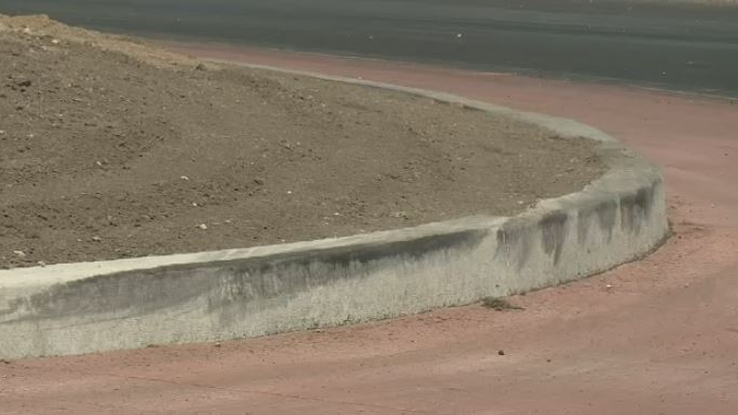 Tire marks are seen on a curb of the roundabout of the newly opened Balgonie overpass Monday, July 31, 2017.