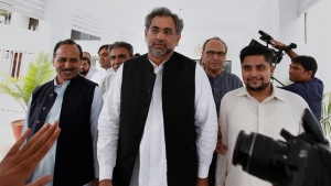 Pakistan's newly-elected Prime Minister Shahid Khaqan Abbasi, center, leaves with his aids after meeting with politicians in Parliament house in Islamabad, Pakistan, July 31, 2017. (Anjum Naveed/AP)