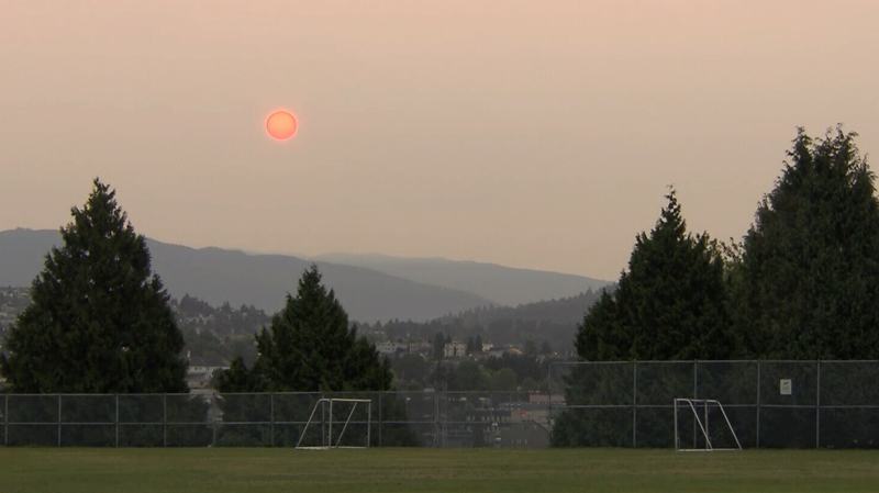The sun rises over a smoky sky in Metro Vancouver. Environment Canada has issued an air quality advisory as smoke from B.C. wildfires blows toward the coast. Aug. 1, 2017. (CTV)