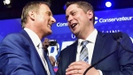 Andrew Scheer, right, is congratulated by Maxime Bernier after being elected the new leader of the federal Conservatives at the party's leadership convention in Toronto on Saturday, May 27, 2017. (Frank Gunn / THE CANADIAN PRESS)