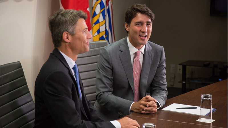 Prime Minister Justin Trudeau and Vancouver mayor Gregor Robertson speak to media before their private meeting in Vancouver, B.C., on Tuesday August 1, 2017. THE CANADIAN PRESS/Ben Nelms