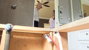 Lydia Cabral show Ross McLaughlin some of the repairs that are being done on her new home, which are covered under home warranty. (CTV)