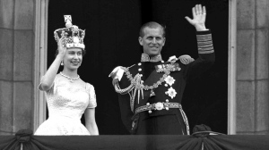 This is a June. 2, 1953 file photo of Queen Elizabeth II and Prince Philip, Duke of Edinburgh, as they wave to supporters from the balcony at Buckingham Palace, following her coronation at Westminster Abbey. London. (AP Photo/Leslie Priest, File)