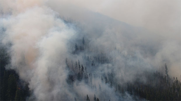 Smoke from the Verdant Creek wildfire is affecting visibility on area highways. (Photo: Parks Canada)