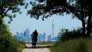 A man rides his bicycle in Humber Bay park in Toronto on Tuesday July 4, 2017. THE CANADIAN PRESS/Frank Gunn