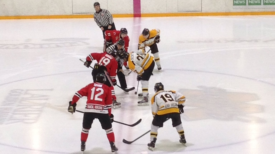 The Cambridge Winter Hawks and Waterloo Siskins line up for a face-off during GOJHL playoff action. (Brandon Bax / CTV Kitchener)