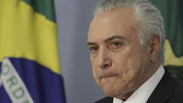 Brazil's President Michel Temer gives a statement at Planalto presidential palace in Brasilia, Brazil, after surviving a key congressional vote that could have suspended him over a bribery charge on Wednesday, Aug. 2, 2017. (AP / Eraldo Peres)