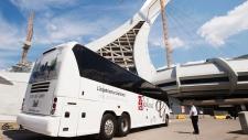 Asylum seekers arrive at Olympic Stadium