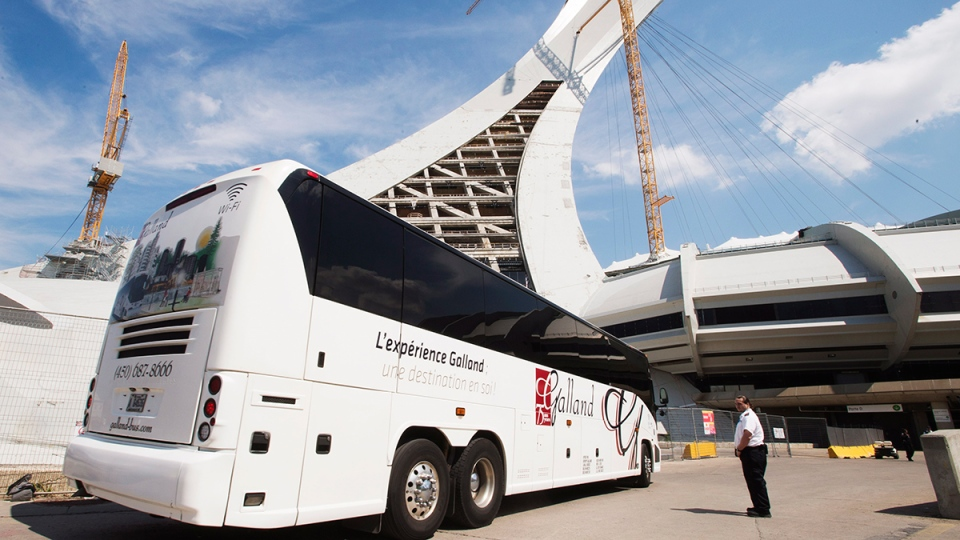 A bus carrying asylum seekers arrives at Olympic Stadium, in Montreal on Wednesday, Aug. 2, 2017. (Ryan Remiorz / THE CANADIAN PRESS)