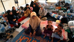 An Indonesian family who escaped from the Islamic State group in Raqqa gathers inside their tent at a refugee camp, in Ain Issa, Syria, Monday, July 24, 2017. (AP / Hussein Malla)