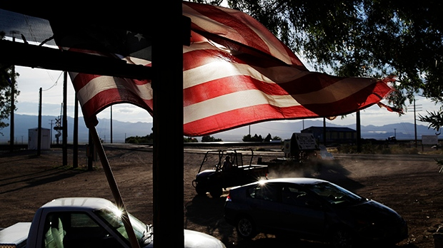 A flag flies in front of a store, Thursday, Aug. 3, 2017, in Nipton, Calif. (AP Photo/John Locher)