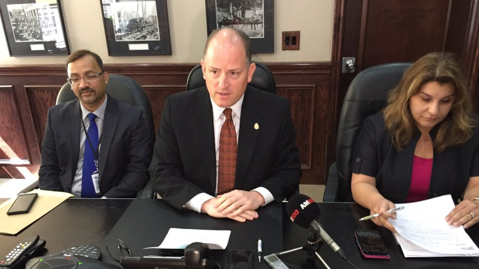 Windsor Mayor Drew Dilkens is flanked by health officials as he launched new initiative aimed at curbing opioid use and abuse in Windsor on Aug. 4, 2017 (Alana Hadadean / CTV Windsor)