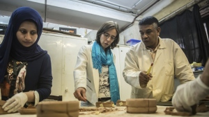 Researcher Anita Quiles (C) and local staff at a dating laboratory in the French Institute of Eastern Archaeology (IFAO) in Cairo. (Khaled Desouki/AFP)