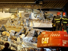 Fire department rescue crews search through rubble in L'Aquila, central Italy, Friday, April 10, 2009. (AP / Antonio Calanni)
