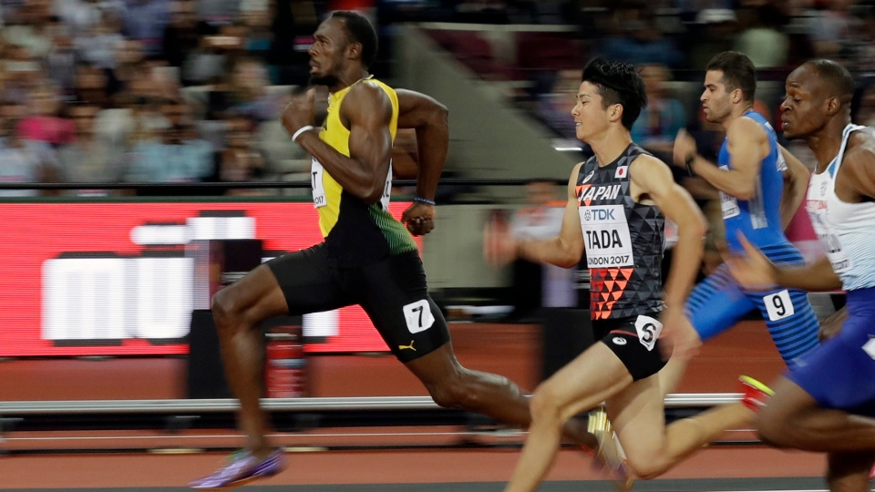 Jamaica's Usain Bolt, left, and Japan's Shuhei Tada, second left, compete in a men's 100m heat during the World Athletics Championships in London Friday, Aug. 4, 2017. (Matt Dunham/AP Photo)
