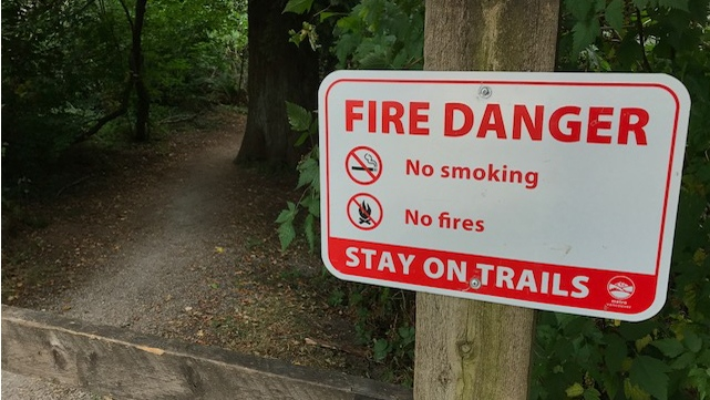 A fire danger sign is seen at Pacific Spirit Regional Park in Vancouver.