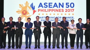 "ASEAN Foreign Ministers link hands ""The ASEAN Way"" at the opening ceremony of the 50th ASEAN Foreign Ministers Meeting at the Philippine International Convention Center Saturday, Aug. 5, 2017 in suburban Pasay city, south of Manila, Philippines. (AP Photo/Mohd Rasfan, Pool)"